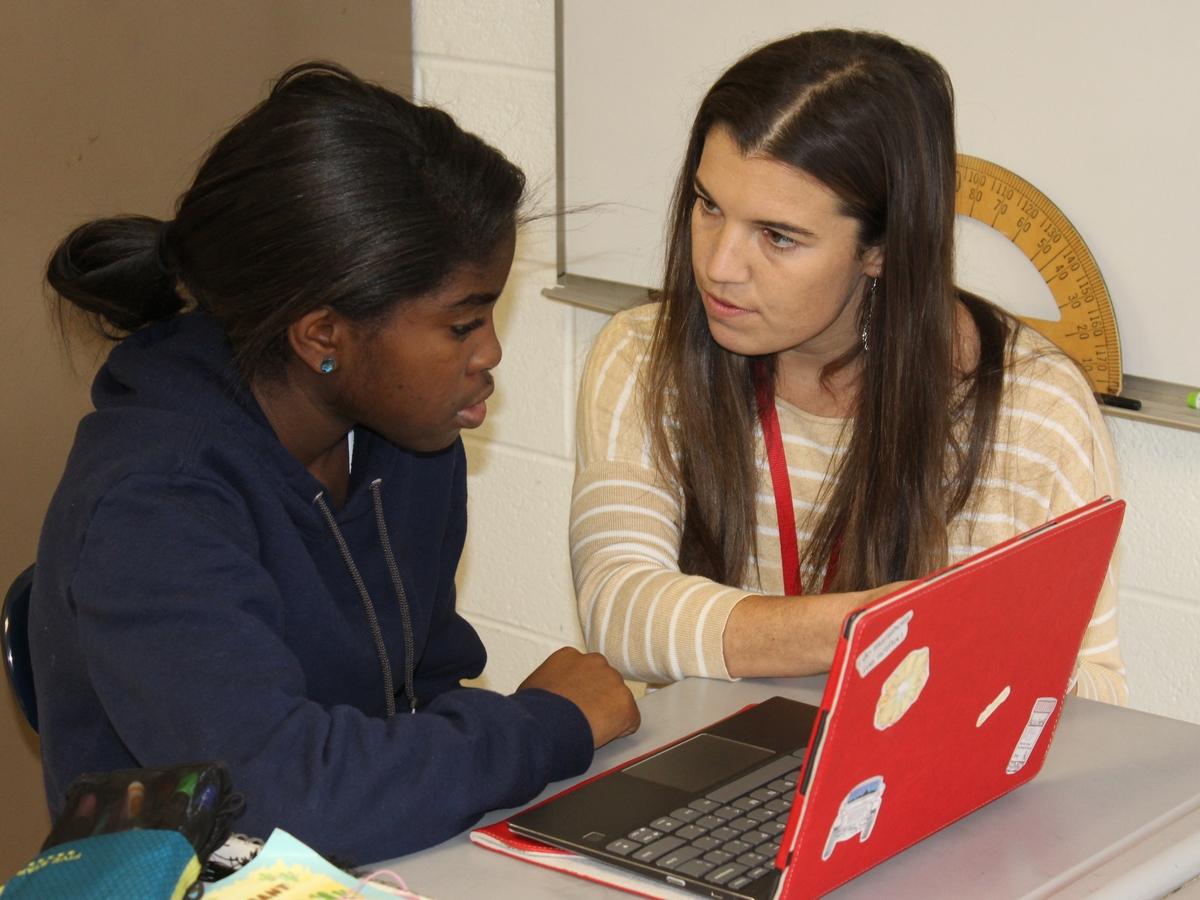Math teacher Sarah Holt instructs a Middle School student