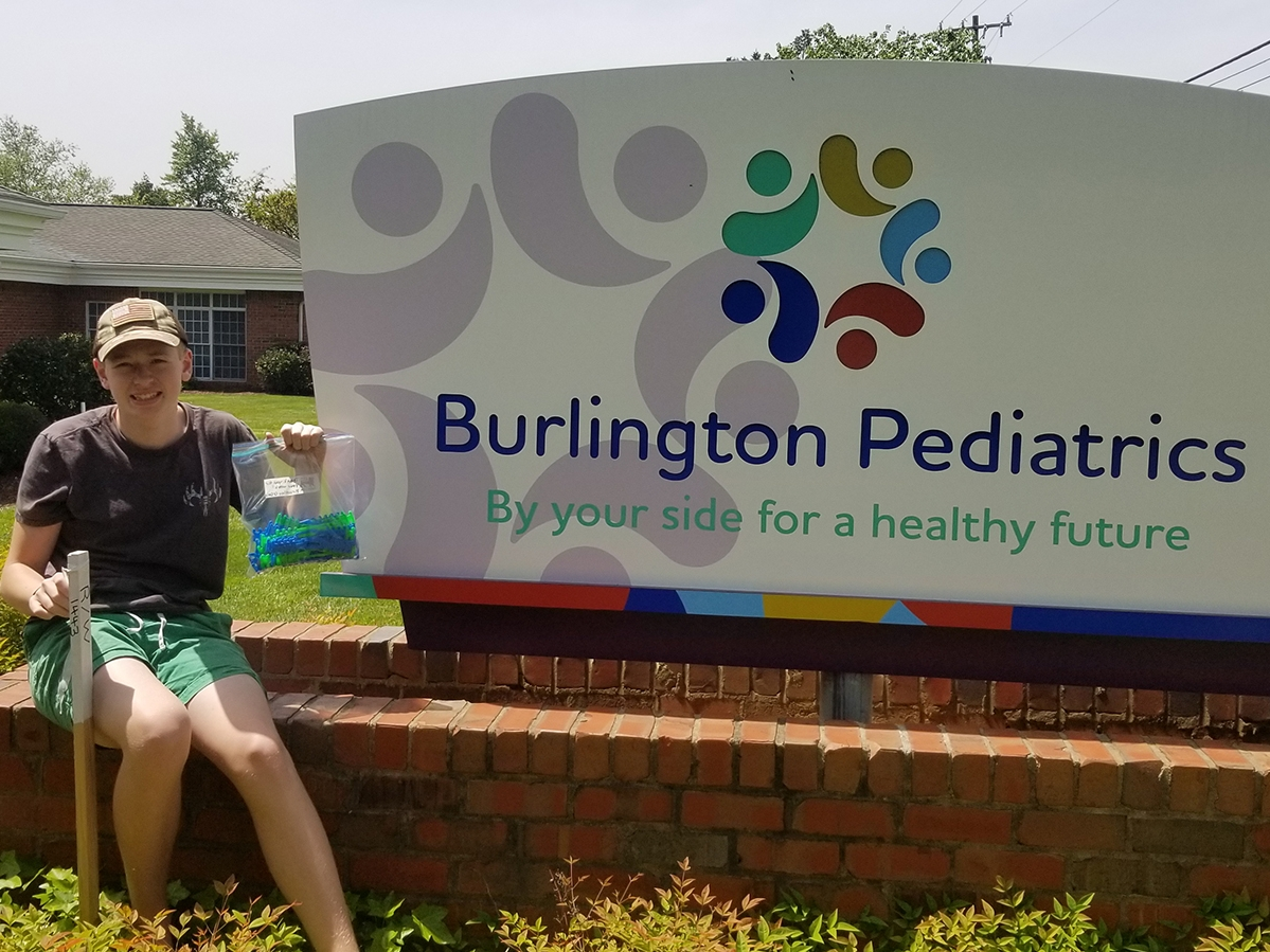 8th grader Brantley O'Day delivers ear savers to Burlington Pediatrics