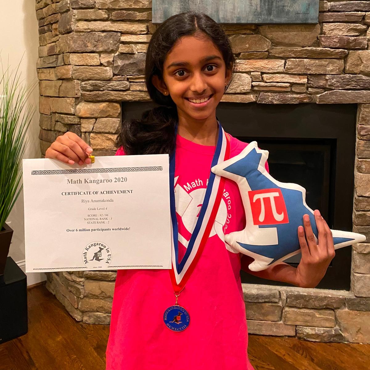 Riya Anumakonda poses with her awards