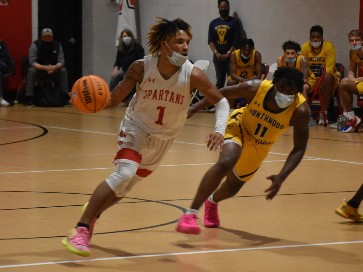 Senior Jamarii Thomas drives with the basketball in the state title game.