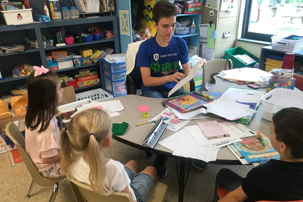 Upper School Spanish student reads to Lower School students