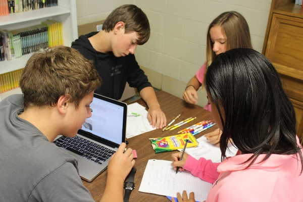 Middle School students collaborate on a project