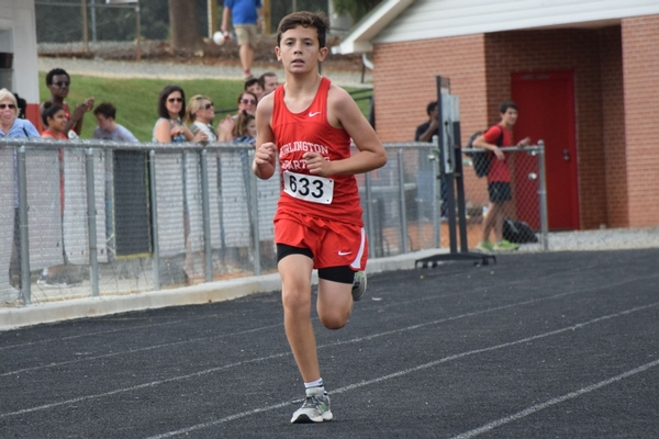 Middle School cross country runner finishes race
