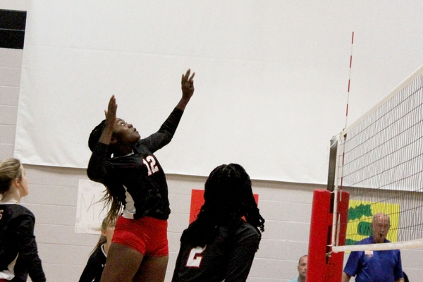 Varsity volleyball action