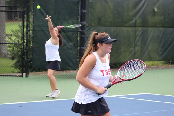 varsity girls tennis action - doubles action