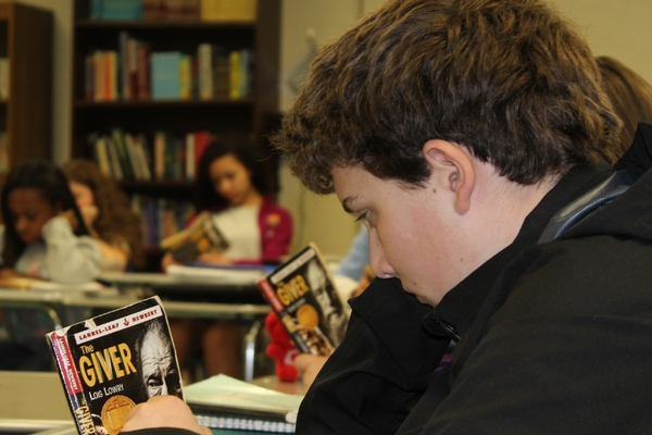 Seventh grade students read their class novel.