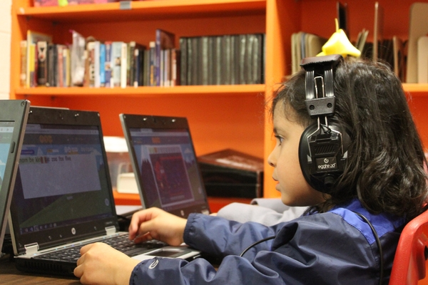 A TK student works on vocabulary in the computer lab