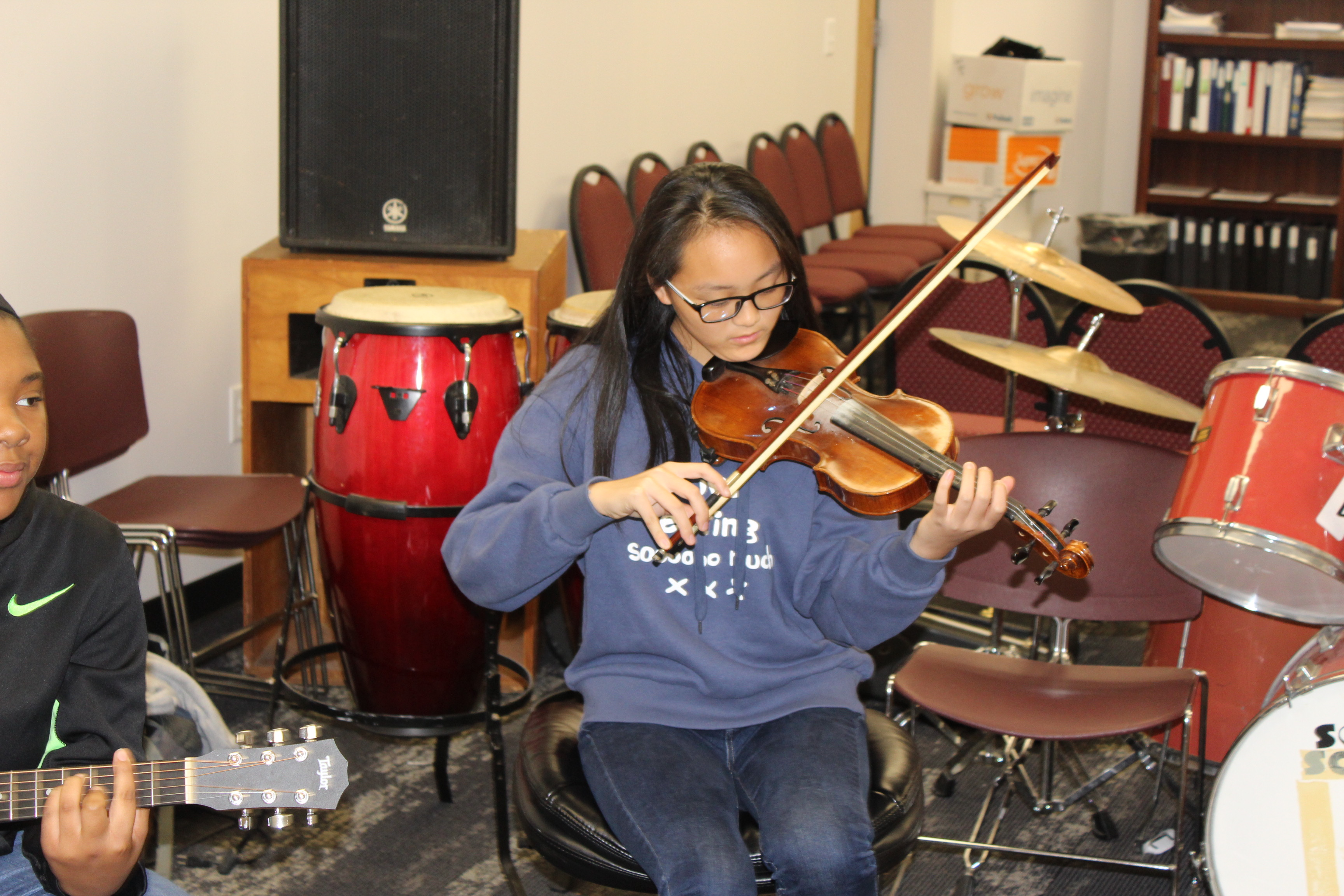 A student from China performs with the rock ensemble.